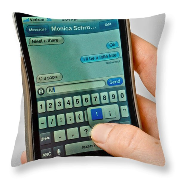 Texting On An Iphone Throw Pillow by Photo Researchers