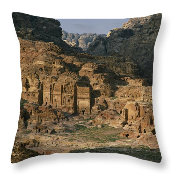 The Caves And Tombs Of Petra, Shown Throw Pillow by Annie Griffiths