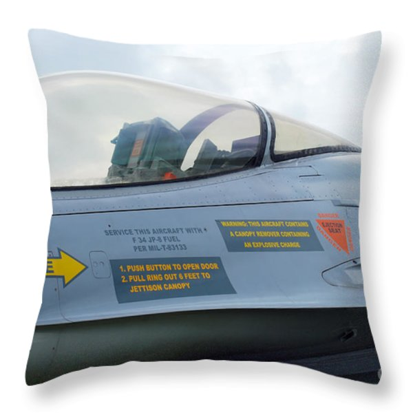 The Cockpit Of An F-16 Fighting Falcon Throw Pillow by Luc De Jaeger
