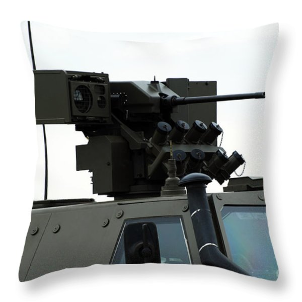 The Gun Mounted On Top Of The Dingo II Throw Pillow by Luc De Jaeger