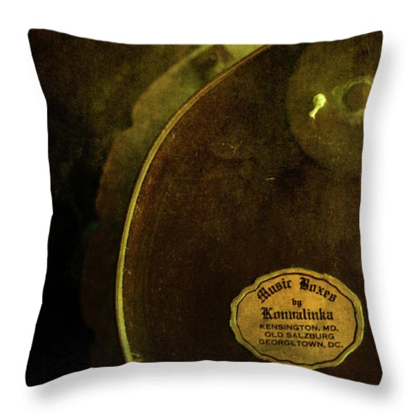 The Konvalinka Music Box Throw Pillow by Rebecca Sherman