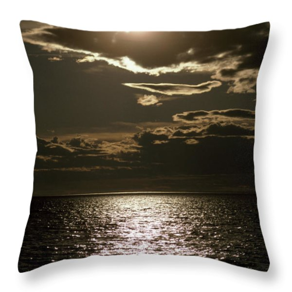 The Setting Sun Pierces A Menacing Throw Pillow by Jason Edwards