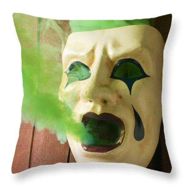 Theater mask spewing green smoke Throw Pillow by Garry Gay