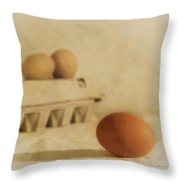 three eggs and a egg box Throw Pillow by Priska Wettstein