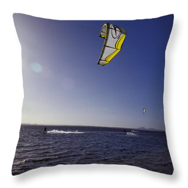 Three Kite Surfers On A Windy Summer Throw Pillow by Jason Edwards