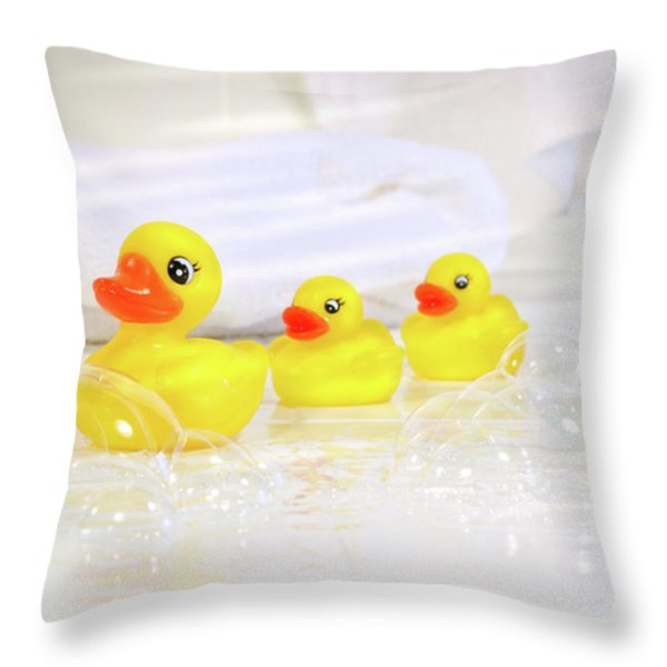 Three Little Rubber Ducks Throw Pillow by Sandra Cunningham