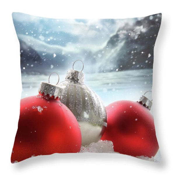 Three Red Christmas Balls In The Snow Throw Pillow by Sandra Cunningham