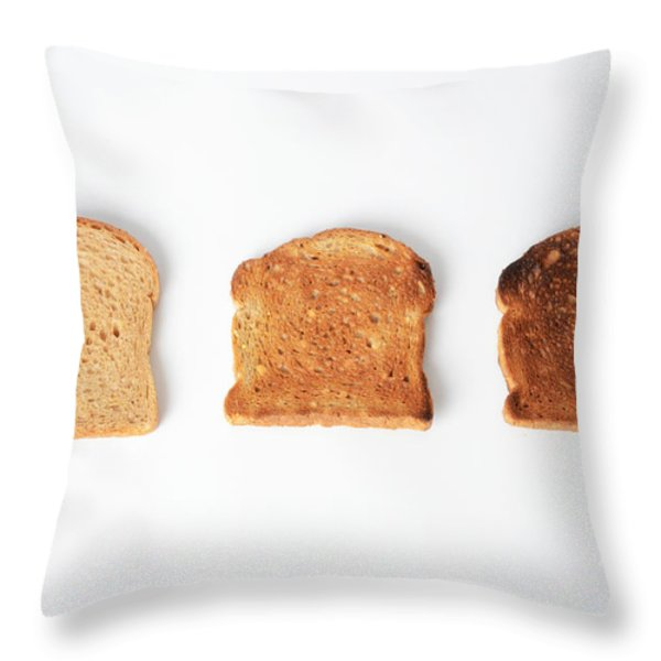 Toasting Bread Throw Pillow by Photo Researchers, Inc.