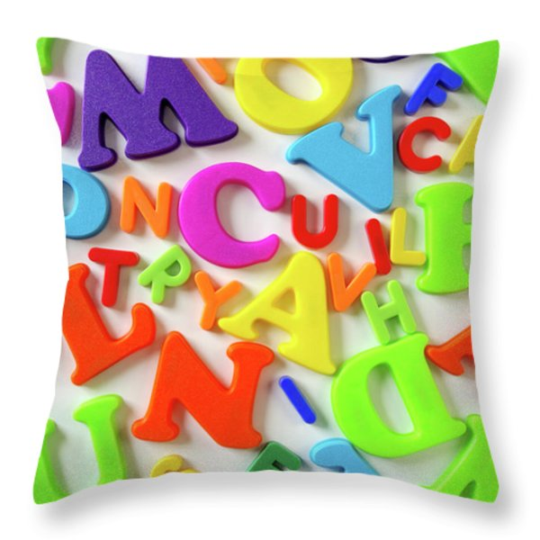 Toy Letters Throw Pillow by Carlos Caetano