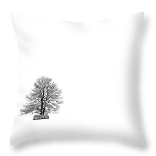 Tree isolated under the snow in the middle field in winter. Throw Pillow by BERNARD JAUBERT