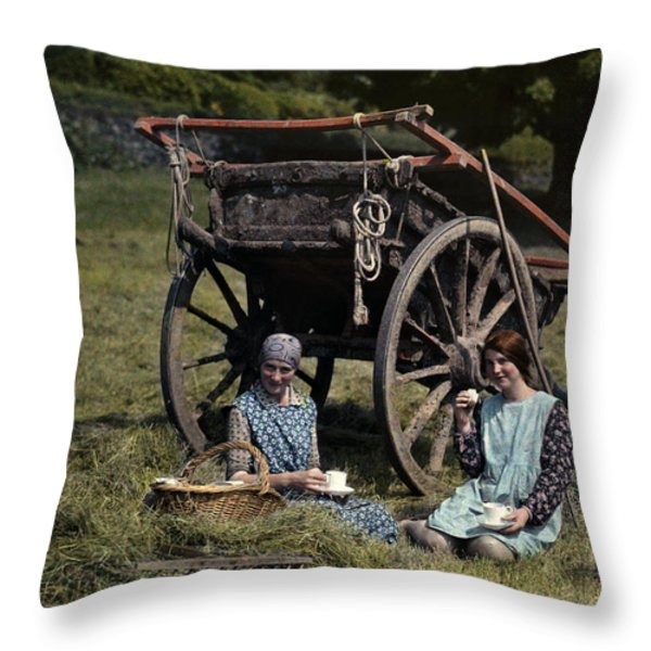 Two Girls Eat Lunch In A Hayfield Throw Pillow by Clifton R. Adams