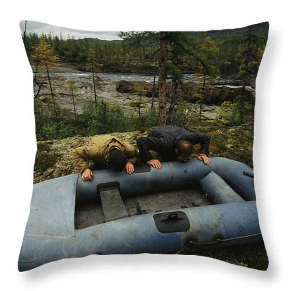 Two Men Use Lung Power To Top Throw Pillow by Randy Olson