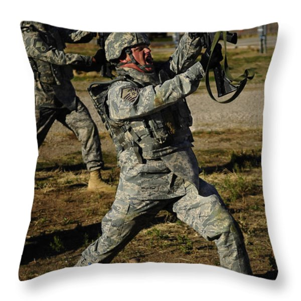 U.s. Air Force Soldier Practices Throw Pillow by Stocktrek Images