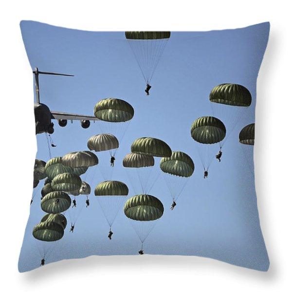 U.s. Army Paratroopers Jumping Throw Pillow by Stocktrek Images