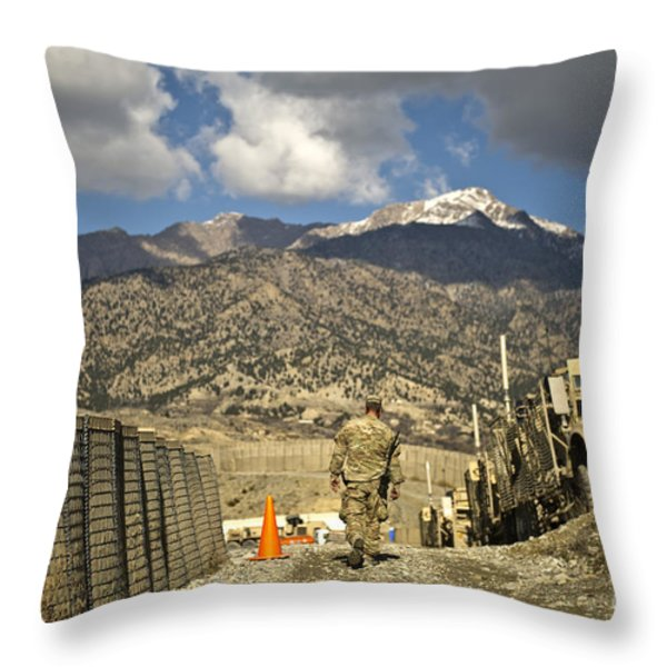 U.s. Army Soldier Walks Down A Path Throw Pillow by Stocktrek Images