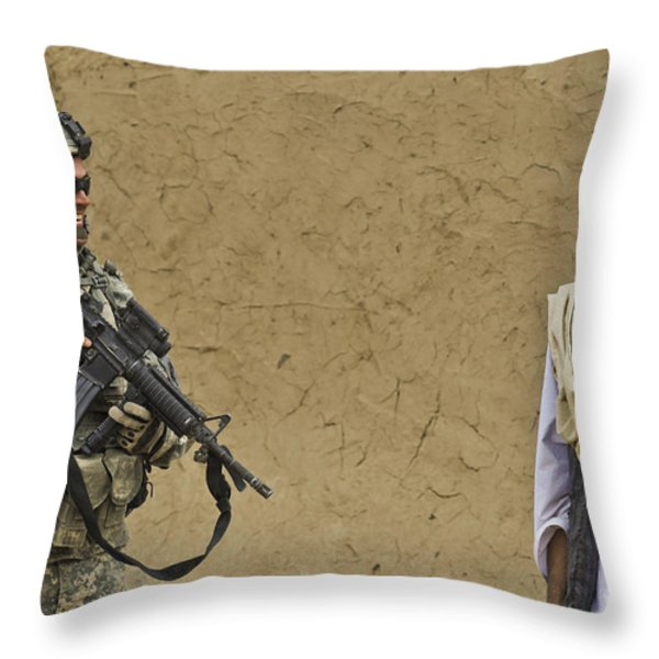 U.s. Army Specialist Talks To An Afghan Throw Pillow by Stocktrek Images