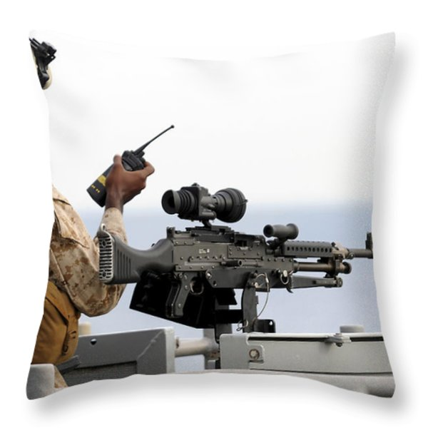 U.s. Marine Talks On A Radio While Throw Pillow by Stocktrek Images