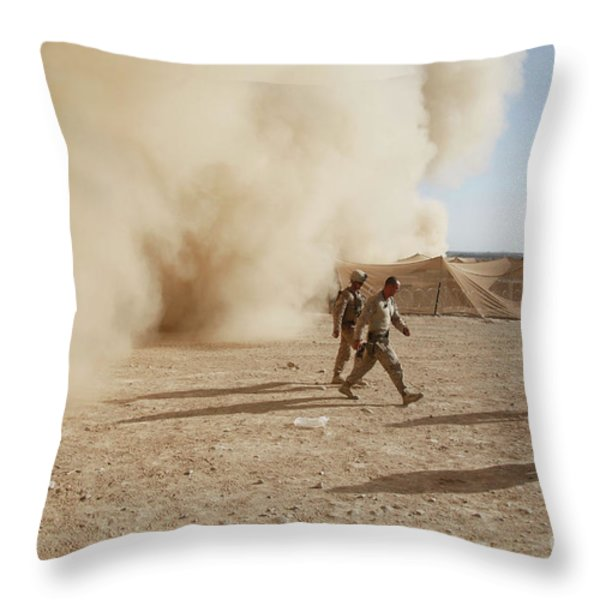 U.s. Marines Walk Away From A Dust Throw Pillow by Stocktrek Images