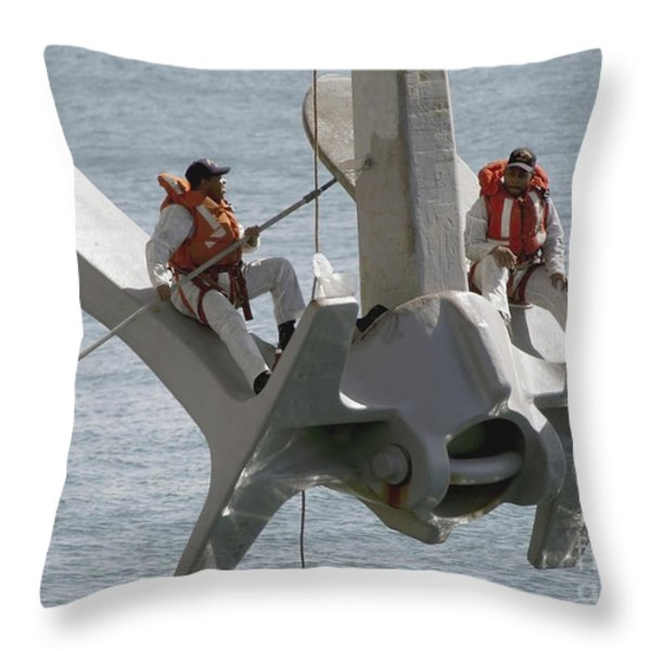 U.s. Navy Servicemen Apply A Coat Throw Pillow by Stocktrek Images