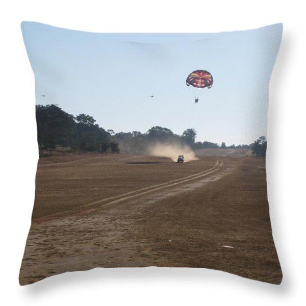Vehicle Pulling A Couple Doing Tandem Parasailing Throw Pillow by Ashish Agarwal