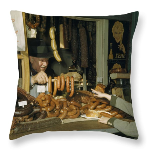 Vendor Holds Up Sausages For Young Girl Throw Pillow by Volkmar Wentzel