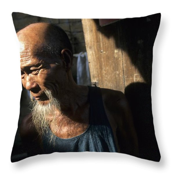 Village Elder At Doorway, Yangdi Throw Pillow by Raymond Gehman