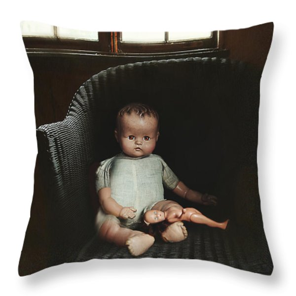 Vintage dolls on chair in dark room Throw Pillow by Sandra Cunningham