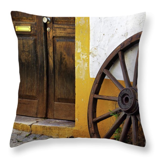 Wagon Wheel Throw Pillow by Carlos Caetano