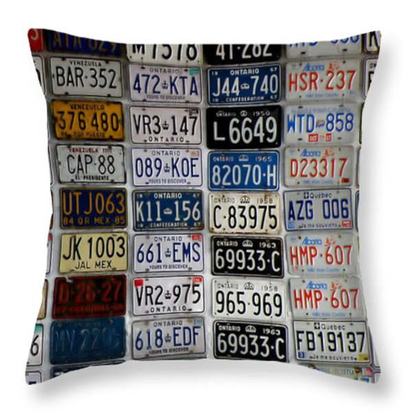 Wall Of License Plates Throw Pillow by Andrew Fare