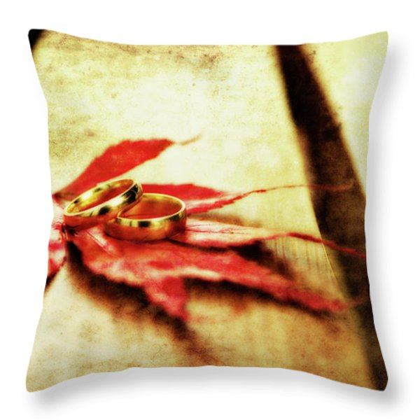 Wedding Rings On Red Throw Pillow by Meirion Matthias