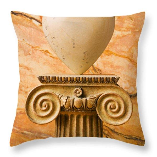 White stone heart on pedestal Throw Pillow by Garry Gay