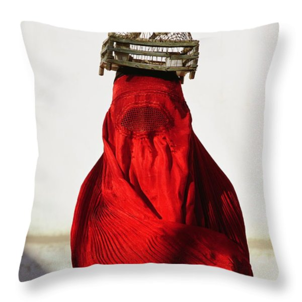 Woman Draped In Red Chadri Carries Throw Pillow by Thomas J. Abercrombie
