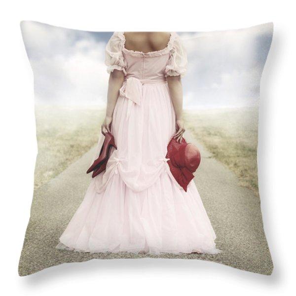 woman on a street Throw Pillow by Joana Kruse