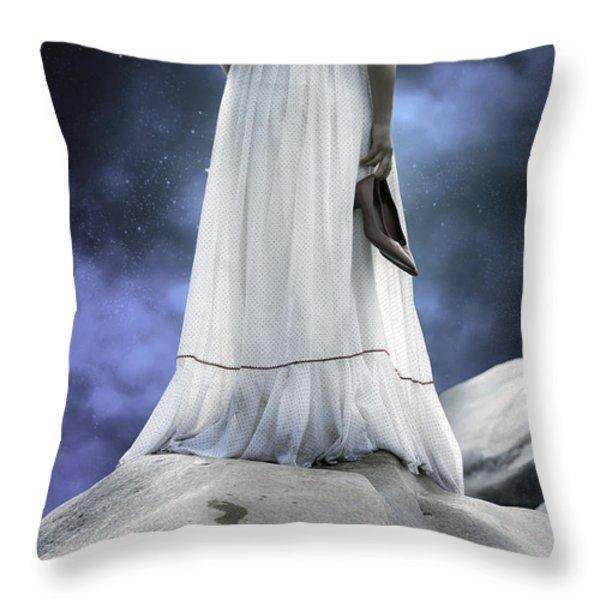 woman on rocks Throw Pillow by Joana Kruse