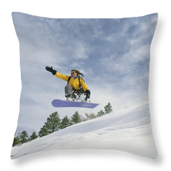 Woman Snowboarding On The Cinder Cone Throw Pillow by Kate Thompson