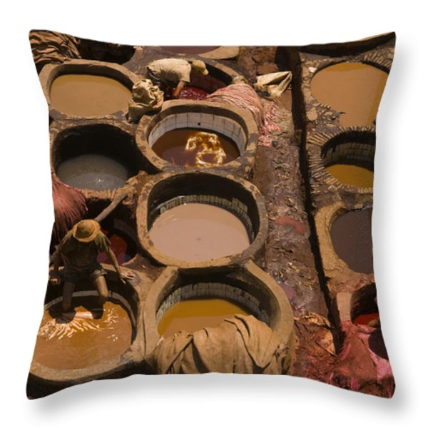 Workers In The Tanneries Of Fez Soak Throw Pillow by Annie Griffiths