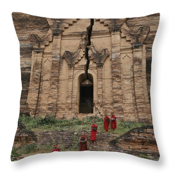 Young Buddhist Monks Near A Ruined Throw Pillow by Paul Chesley