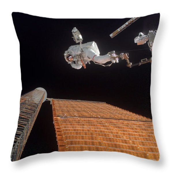 An Astronaut Anchored To A Foot Throw Pillow by Stocktrek Images