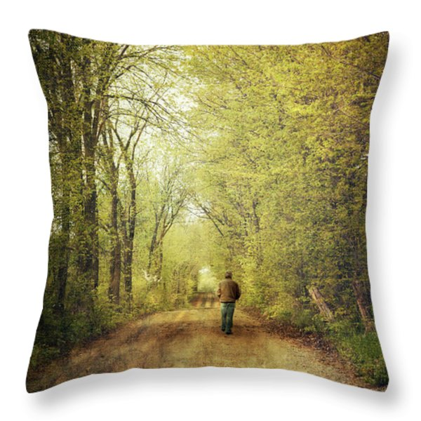 Man Walking  On A Lonely Country Road Throw Pillow by Sandra Cunningham