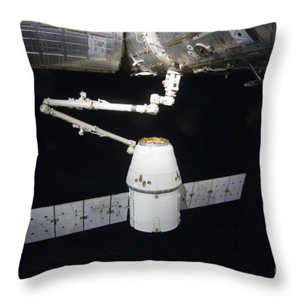 The Spacex Dragon Cargo Craft Prior Throw Pillow by Stocktrek Images