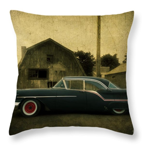 1957 Oldsmobile Throw Pillow by Joel Witmeyer