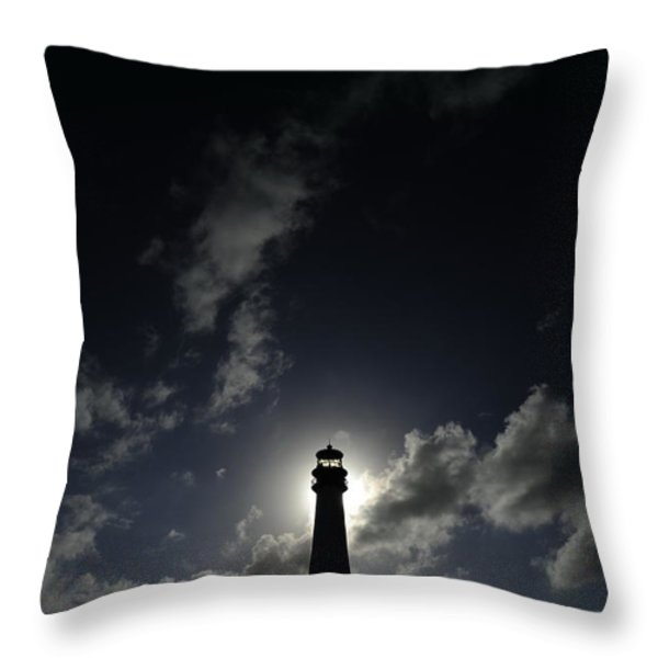 A Backlit View Of A Lighthouse Built Throw Pillow by Raul Touzon