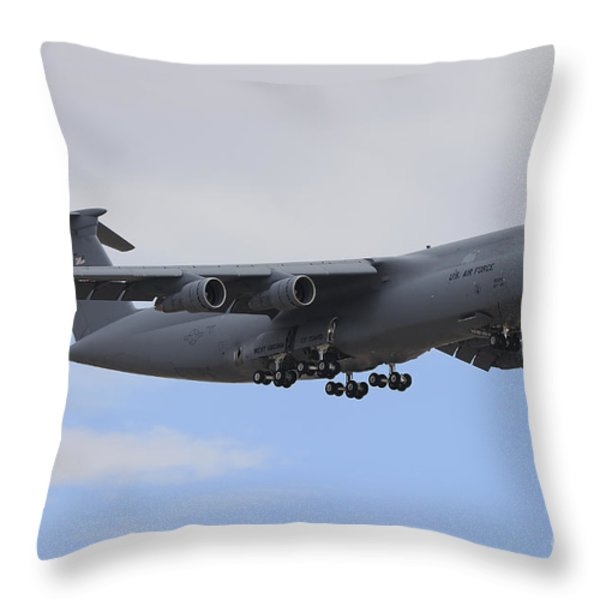 A C-5 Galaxy In Flight Over Nevada Throw Pillow by Remo Guidi