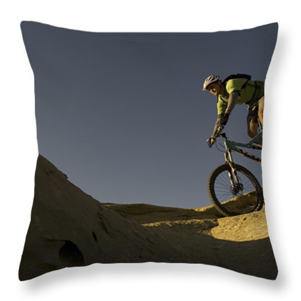 A Caucasian Man Mountain Biking Throw Pillow by Bobby Model