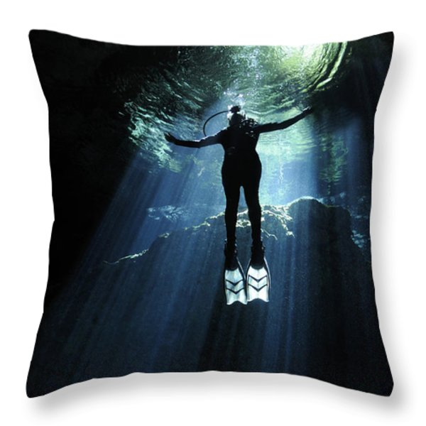 A Cavern Diver Ascends In The Cenote Throw Pillow by Karen Doody