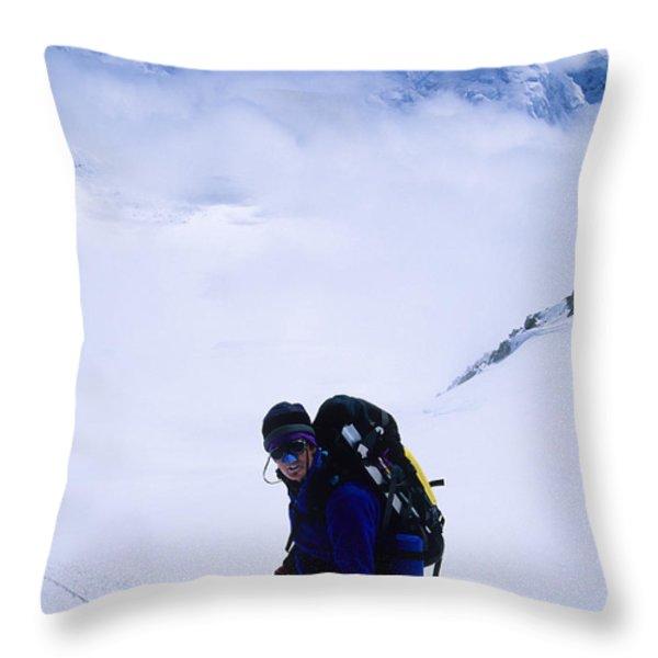 A Climber On The Descent Throw Pillow by Bill Hatcher