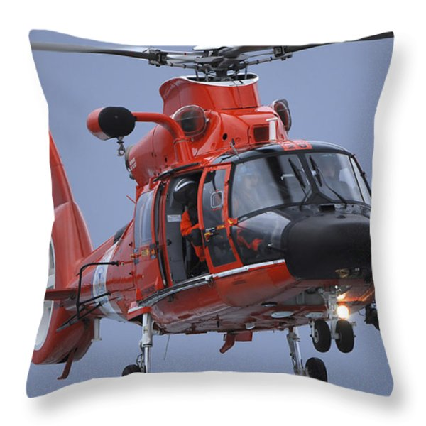 A Coast Guard Mh-65 Dolphin Helicopter Throw Pillow by Stocktrek Images