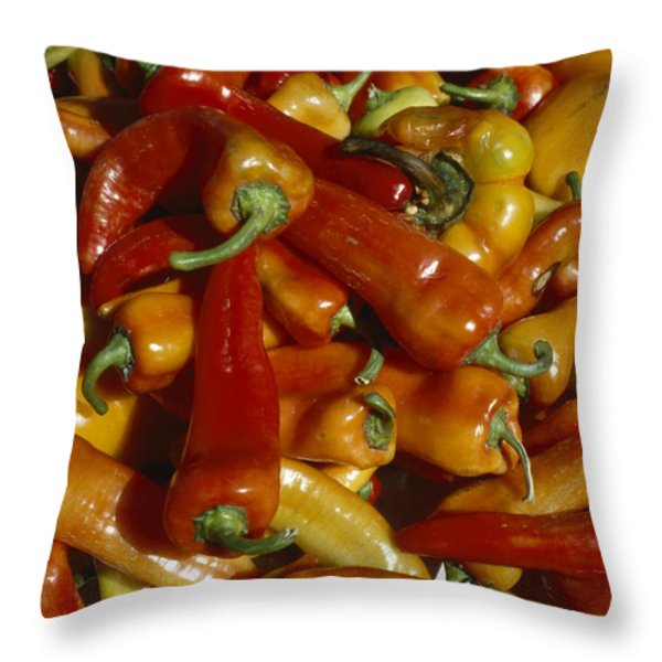 A Colourful Pile Of Throw Pillow by Taylor S. Kennedy
