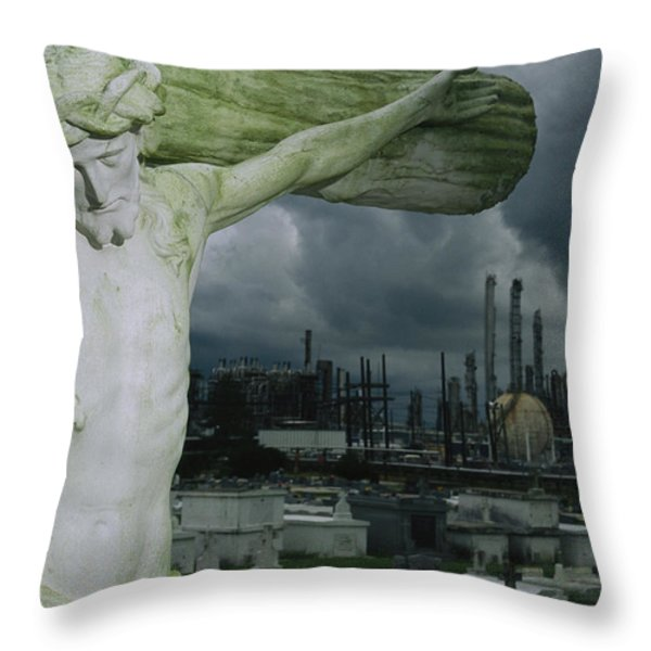 A Crucifixion Statue In A Cemetery Throw Pillow by Joel Sartore