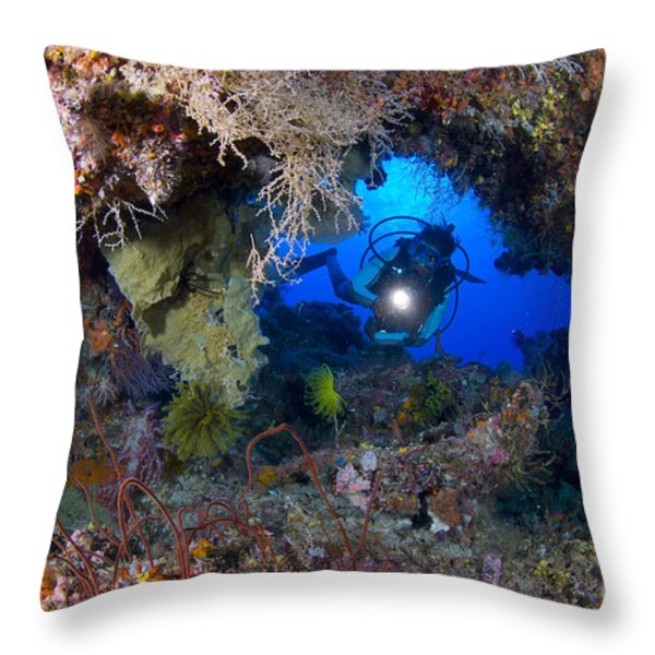 A Diver Peers Through A Coral Encrusted Throw Pillow by Steve Jones